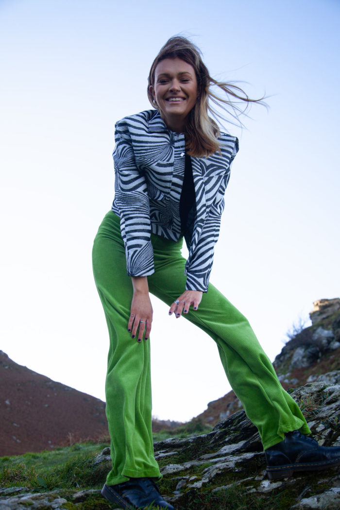 Model Wearing Apple Green Velour Trousers With Monochrome Patterned Jacket