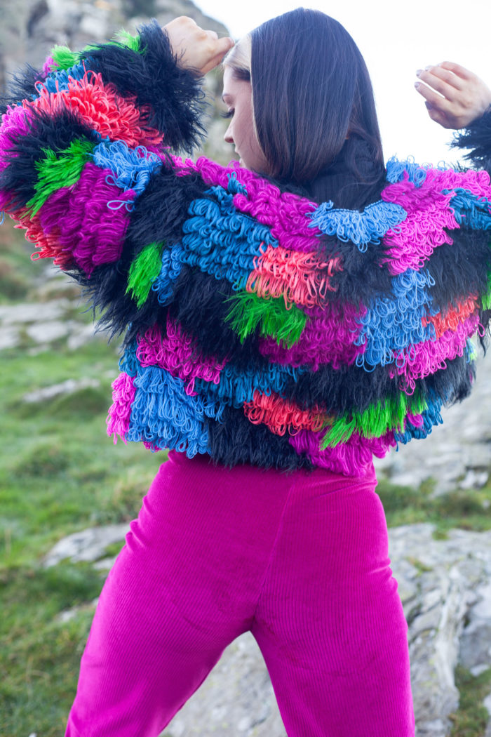 Rear View of Multi-coloured Textured Cardigan with Dark Pink Velour Trousers