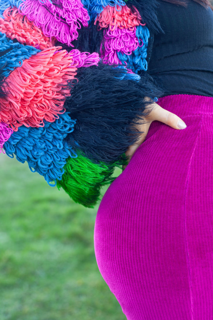 Close-up of Multi-coloured Textured Cardigan with Dark Pink Velour Trousers